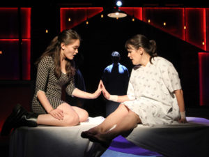"Isa Briones (Natalie) and Michelle Lane (Diana) in ""Next to Normal"" (photo by John Dlugolecki)"