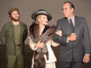 "Marc Baron Ginsburg (Che), Cassandra Murphy (Eva Peron), and David Kirk Grant (Juan Peron) in ""Evita"" (photo by Ed Krieger)"